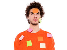 One young man portrait covered by  adhesive notes Royalty Free Stock Photography