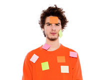 One young man portrait covered by  adhesive notes Royalty Free Stock Photos
