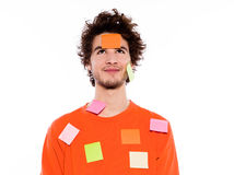 One young man portrait covered by  adhesive notes Royalty Free Stock Photo