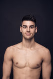One young man shirtless smile smirk. One young man only, head and shoulders, shirtless smiling smirk royalty free stock photos