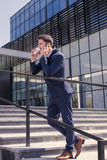 One young man, suit tie, talking over phone, outdoors day, moder Royalty Free Stock Images