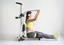 One young pregnant woman doing fitness exercises Royalty Free Stock Images