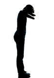 One young teenager boy or girl crying silhouette Stock Photos