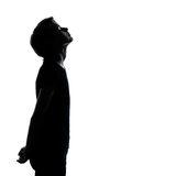 One young teenager boy or girl looking up. One caucasian young teenager silhouette boy or girl looking up portrait in studio cut out isolated on white background Royalty Free Stock Photo