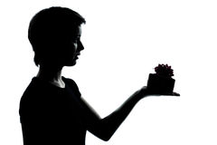One young teenager boy or girl offering present gift silhouette Stock Photography