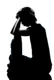 One young teenager boy girl pouting sadness. One caucasian young teenager silhouette boy or girl pouting sadness  full length in studio cut out isolated on white Stock Photo