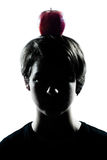 One young teenager boy or girl silhouette with an apple on his h Royalty Free Stock Photos