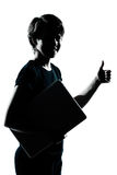 One young teenager boy girl silhouette holding carrying laptop c Royalty Free Stock Image