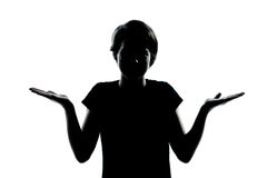 One young teenager boy or girl silhouette ignorant hesitation sh Stock Images