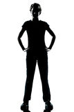 One young teenager boy or girl silhouette standing hands on hips Stock Photo
