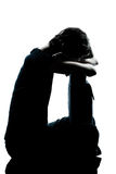 One young teenager girl crying sad silhouette Royalty Free Stock Image
