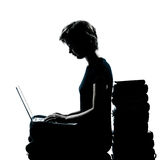 One young teenager girl silhouette computer computing laptop boo Royalty Free Stock Photo