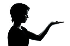 One young teenager girl silhouette empty hands open Stock Photo