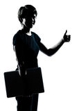 One young teenager girl silhouette holding carrying laptop compu Royalty Free Stock Images