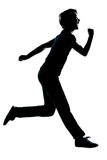 One young teenager running laughing silhouette Royalty Free Stock Image