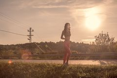 One young woman, outdoors jogging, sport clothes, Sun sky, warm Royalty Free Stock Photos