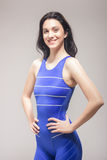 One young woman standing, smiling swimmer swimsuit Royalty Free Stock Images