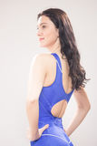 One young woman swimmer swimsuit, smiling, rear view Stock Photography