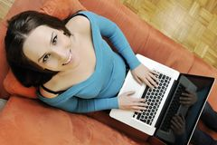 One young woman working on laptop Royalty Free Stock Photos