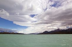 Onelli Glacier view from the Argentino Lake, Argentina. Onelli Glacier with amazing sky view from Lake Argentino in Patagonia, Argentina. Onelli Glacier is a stock photo