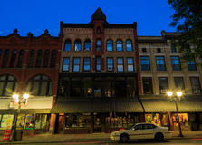 Oneonta NY city streets, downtown scene. Oneonta, NY, USA - July 2016 downtown, with historic buildings, shops and restaurants in the evening hours. Night scene Stock Photo