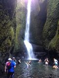 Oneota Falls. Hikers play in the plunge pool at the base of Oneota Falls Stock Photo