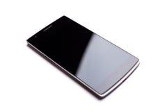 OnePlus одна лицевая сторона Smartphone изолированная на белой предпосылке Стоковые Изображения RF