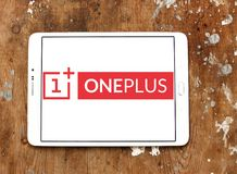 OnePlus smartphone manufacturer logo. Logo of smartphones company OnePlus on samsung tablet on wooden background. OnePlus is a Shenzhen based Chinese smartphone Royalty Free Stock Image