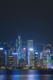 Ong Kong city skyline at night over Victoria Harbor Stock Image