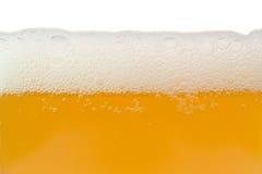 Ongefilterd bier met schuim Royalty-vrije Stock Afbeeldingen