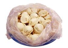Ongekookte bollen in het pakket. Royalty-vrije Stock Foto