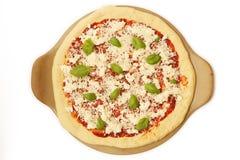 Ongekookte pizza Stock Foto's