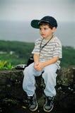 Ongelukkig Little Boy met Camera royalty-vrije stock foto