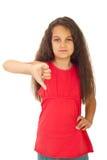 Ongelukkig meisje met neer duim Stock Foto