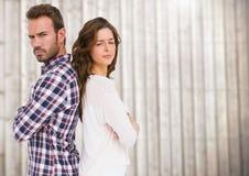 Ongelukkig Paar die zich rijtjes bevinden stock foto