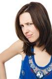 Ongelukkige jonge vrouw die op witte achtergrond wordt geïsoleerd Royalty-vrije Stock Foto