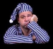 Ongelukkige mens in pyjama's royalty-vrije stock fotografie