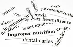 Ongepaste voeding. Gezondheidszorgconcept ziekten door ongezonde voeding worden veroorzaakt die Stock Foto's
