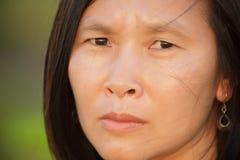 Ongerust gemaakte Aziatische vrouw Royalty-vrije Stock Foto's