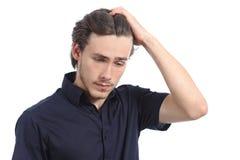 Ongerust gemaakte gedeprimeerde mens met de hand op het hoofd Stock Foto