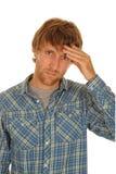 Ongerust gemaakte jonge mens Stock Foto