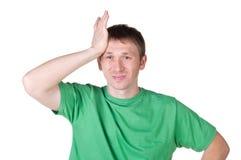 Ongerust gemaakte jonge mens die aan hoofdpijn lijden Stock Foto