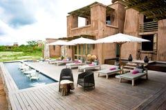 Onguma Plains Camp, Safari Lodge, Resort, Namibia. Patio with pool for chairs of Lodge in Etosha Pan, Namibia stock photography