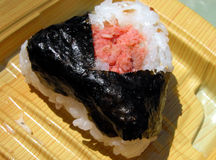 Onighiri. Is a rice triangle which contains different kinds of meat,or some vegetables inside.It is a very common and cheap snacks in Japan.This one contains Royalty Free Stock Photography