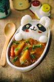 在日本咖喱可爱/逗人喜爱的食物的豹猫Onigiri 免版税库存图片