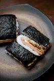 Onigiri japonais de tamago de porc de cuisine Photographie stock