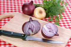 Onion. Red onion and knife. Food background Royalty Free Stock Image