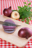 Onion. Red onion and knife. Food background Stock Image