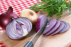 Onion. Red onion and knife. Food background Royalty Free Stock Photos