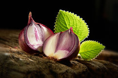 Onion. On old wooden table with mood lighting Stock Photo